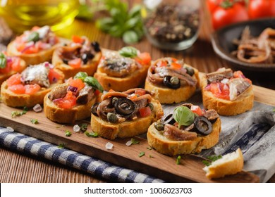 Mix Bruschetta with sardines and anchovies. Front view.
