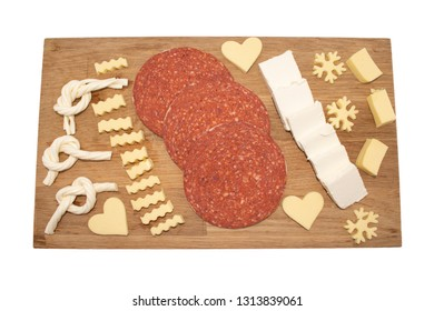 mix of cheese and sucuk (sujuk). Salami sucuk (sujuk) cheese on kitchen board with. Sliced sucuk with cheese on a wooden plate isolated