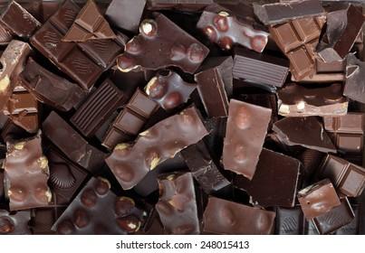 Mix of chocolate bar pieces made of dark chocolate, milk chocolate