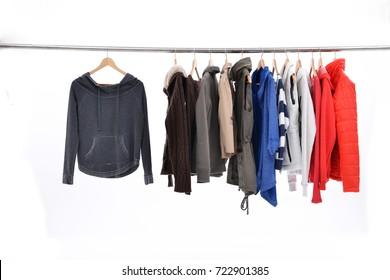 Mix color row of female,coat ,jacket ,sundress on hanging