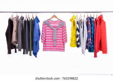 Mix color row of female,coat ,jacket ,sundress on hanging