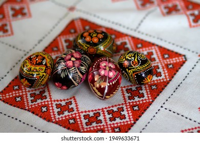 Mix of colored easter eggs with the traditional ukrainian slavic designs. Beautiful pysanka handmade - ukrainian traditional on a traditional embroidered tablecloth vyshyvanka. Selective focus - Shutterstock ID 1949633671