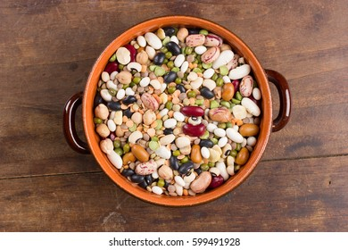Mix of colorful beans and lentils in bowl. Top view.
