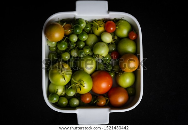 Mix colour tomatoes on black background