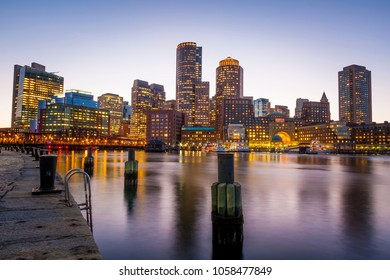 the mix of contemporary and historic architecture of Boston in Massachusetts, USA at sunset showcasing a view of downtown from the Fan Pier.
