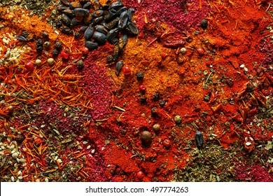 Mix of different flavored spices background