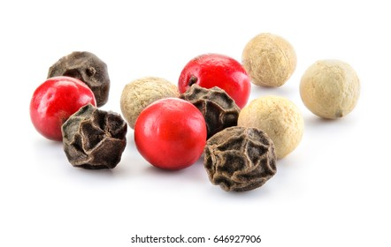 Mix of different peppers. Spice macro. Dry peppercorns isolated on white background. Full depth of field.
