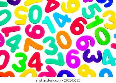 A mix of different single digit numbers from zero to nine, of different bright colors, on a white background.