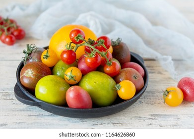 Mix of different varieties of tomato for cooking your favorite salads and snacks, your own garden and harvest, cherry red and yellow, a variety of kiwi