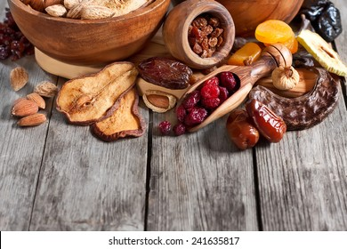 Mix of dried fruits and almonds - symbols of judaic holiday Tu Bishvat. Copyspace background.