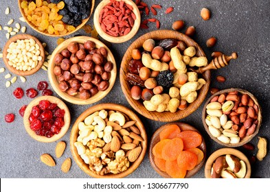 Mix of dried fruits and nuts on stone table - symbols of judaic holiday Tu Bishvat.  Top view.