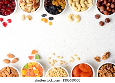 Mix of dried fruits and nuts on stone table - symbols of judaic holiday Tu Bishvat. Copyspace background.