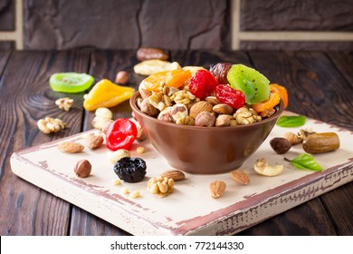 Mix of dried fruits and nuts on a wooden background. The concept of the Jewish holiday Tu Bishvat.