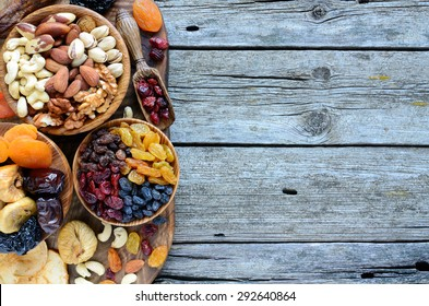 Mix of dried fruits and nuts - symbols of judaic holiday Tu Bishvat. Copyspace background.