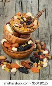 Mix of dried fruits and nuts in a wooden bowl - symbols of judaic holiday Tu Bishvat.