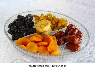 Mix of dried fruits - symbols of Jewish holiday Tu Bishvat. Apricots, Dates, Raisins, Prunes, Figs in a glass tray, Israel
