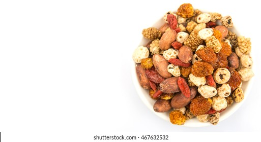 Mix dried super food tiger nuts, mulberry berries, cacao beans, goji berries, golden berry over white background