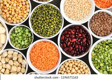 Mix of dry legume varieties: pinto and mung beans, assorted lentils, soyabean, yellow and green peas, chickpea; vegan high protein food for healthy diet
