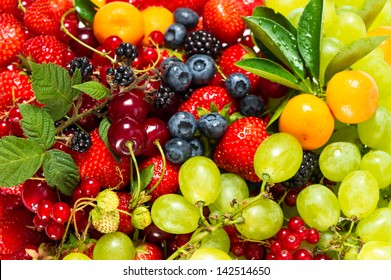 mix of fresh fruits and berries. raw food ingredients. nutrition background