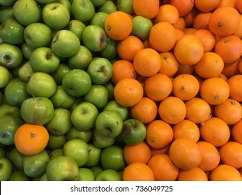 A mix of fresh Orange and green apple background
