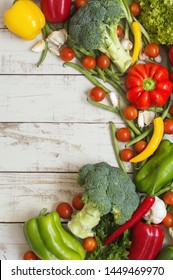 Mix of fresh seasonal vegetables on wooden background. Healthy eating concept. Plant based diet