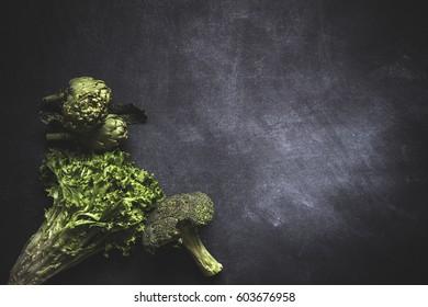 Mix of fresh vegetables on black background