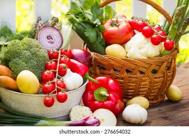 Mix of fresh vegetables in wicker basket