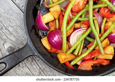 Mix of fried vegetables on frying pan , upper view