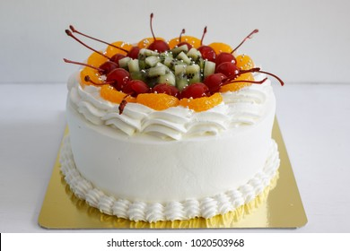 Mix fruit with vanilla butter cream cake.