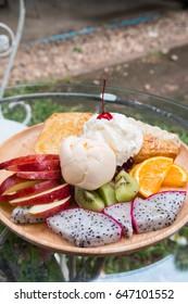mix fruit with vanilla ice cream, whipped cream and honey toast