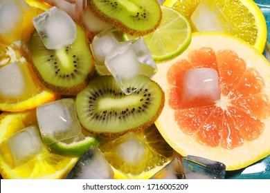 mix of fruits and ice, close-up of kiwi lime grapefruit. flat lay. top view, copy space.