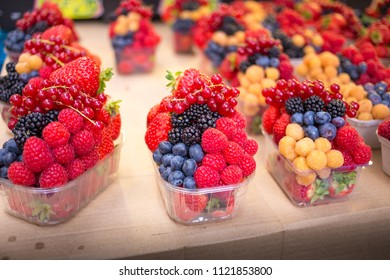 Mix fruits in an open transparent plastic recipient