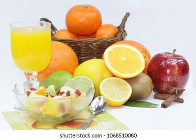 Mix of fruits and orange juice on white background