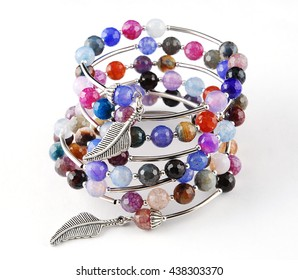 Mix gems bracelet on white background