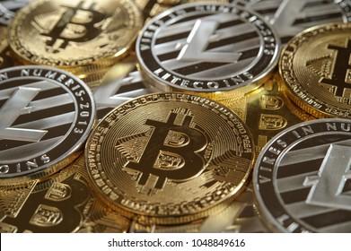 Mix of golden bitcoin and silver litecoin coins