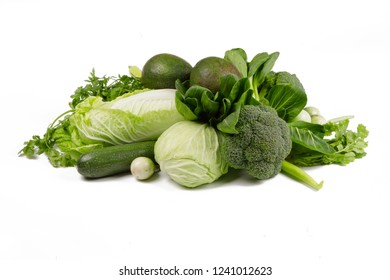 Mix of Green vegetables isolated on white background