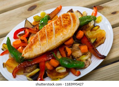 Mix of grilled vegetables with baked chicken breast - traditional Bulgarian Plakiya
