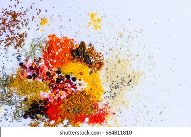 Mix of herbs and spices isolated on white background