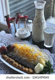 Mix Kubideh - one skewer of ground beef and one skewer of ground chicken, seasoned and flame broiled, served with grilled tomatoes and basmati rice.