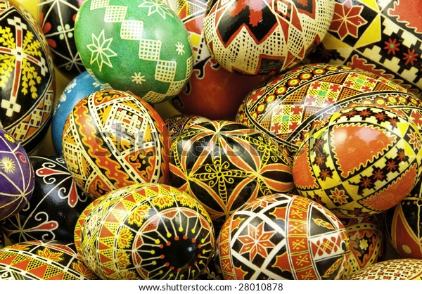 Mix of large and small eggs with the traditional designs on the eggs.
