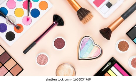 A mix of makeup and brushes