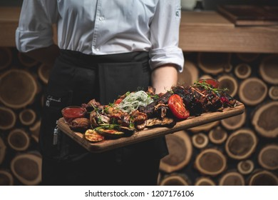 mix meat on a board in a hand for a waiter