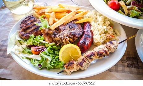 Mix meat plate with french fries, Greek Food.