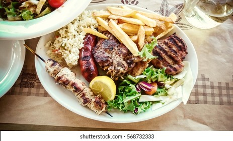 Mix meat plate with french fries, Greek food