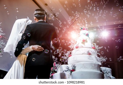 mix modern musalim wedding ceremony to cutting cake. Decoration wedding with cake bubble and lighting in ceremony.