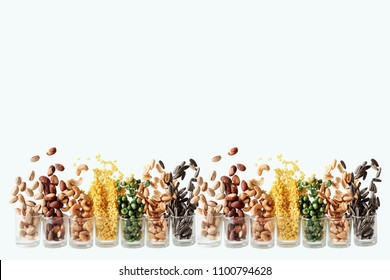 Mix Nuts in the glass on white background close up nuts pistachios  almond cashew nuts peanut sunflower seeds