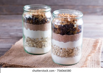 Mix of nuts in a jar. Mixing of ingredients for cookies in a jar