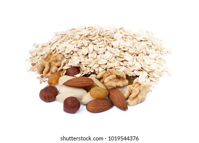 Mix nuts, raisins and oatmeal isolated on white background