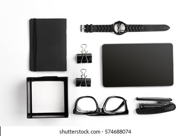 Mix of office supplies and business gadgets on a modern  desk