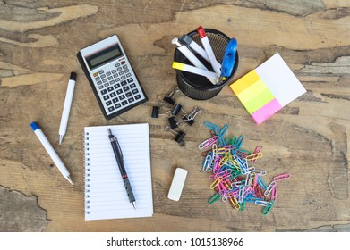 Mix of office supplies on a wooden table, top view